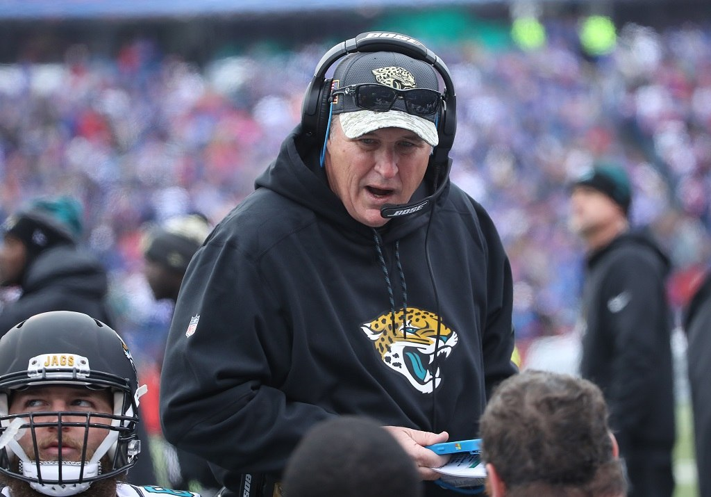 Assistant head coach Doug Marrone of the Jacksonville Jaguars talks to his players on the bench during NFL game action against the Buffalo Bills | Tom Szczerbowski/Getty Images