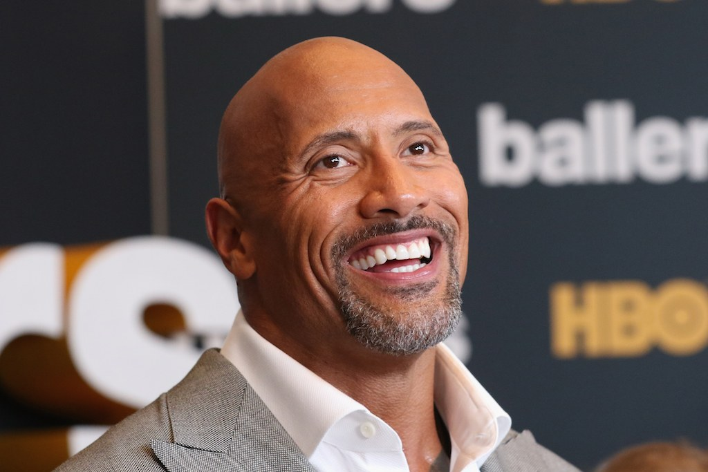 "Dwayne Johnson smiles during a ""Ballers"" media event."