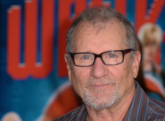 Ed O'Neil stands on the red carpet during a television show premiere.