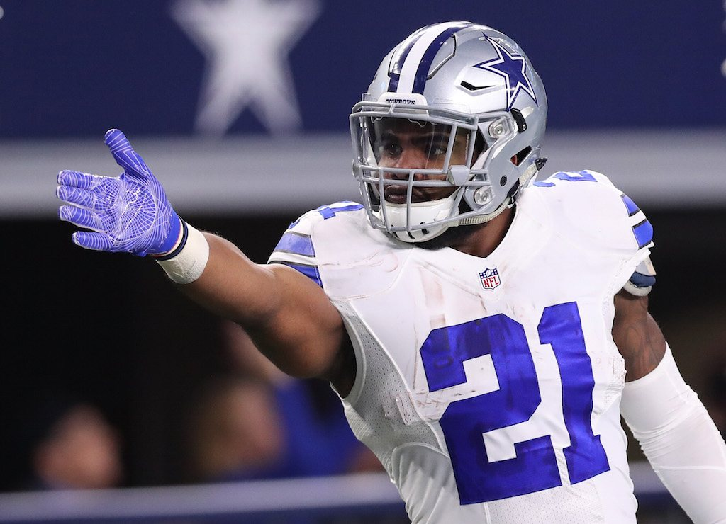 Ezekiel Elliott #21 of the Dallas Cowboys celebrates after rushing for a first down.