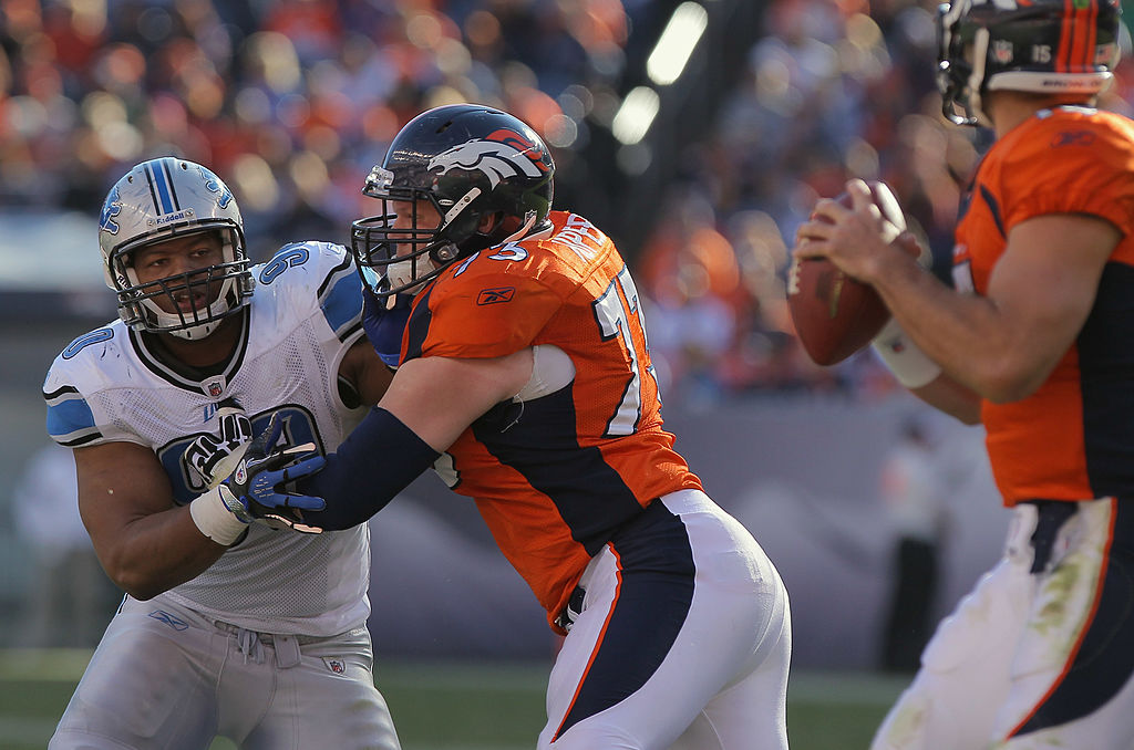 Defensive tackle Ndamukong Suh of the Detroit Lions battles against the block of offensive guard Chris Kuper of the Denver Broncos.
