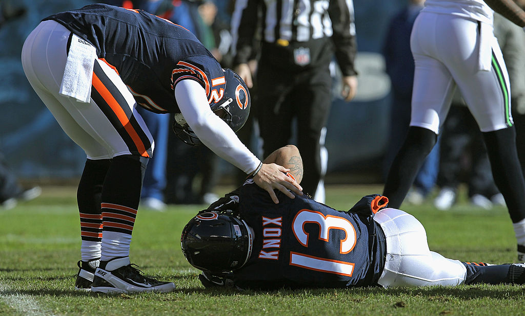 Caleb Hanie of the Chicago Bears checks on teammate Johnny Knox after Knox was injured against the Seattle Seahawks.