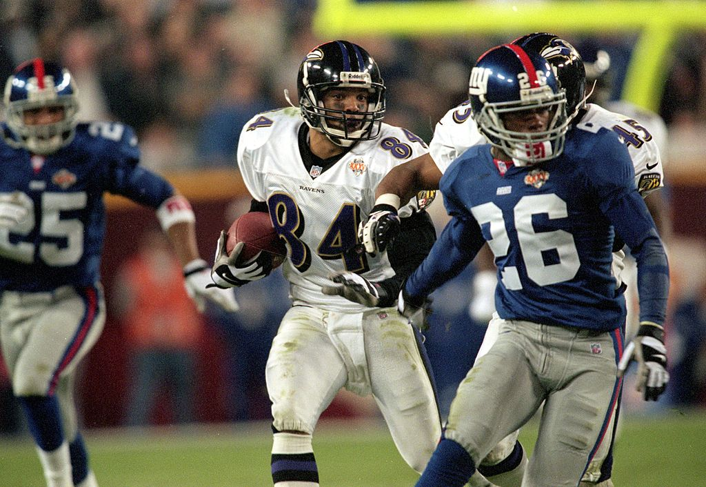 Jermaine Lewis of the Baltimore Ravens runs with the ball for a run back touchdown during Super Bowl XXXV.
