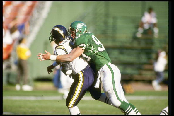 Defensive lineman Dennis Byrd of the New York Jets tackles San Diego Chargers quarterback Billy Joe Hobert.