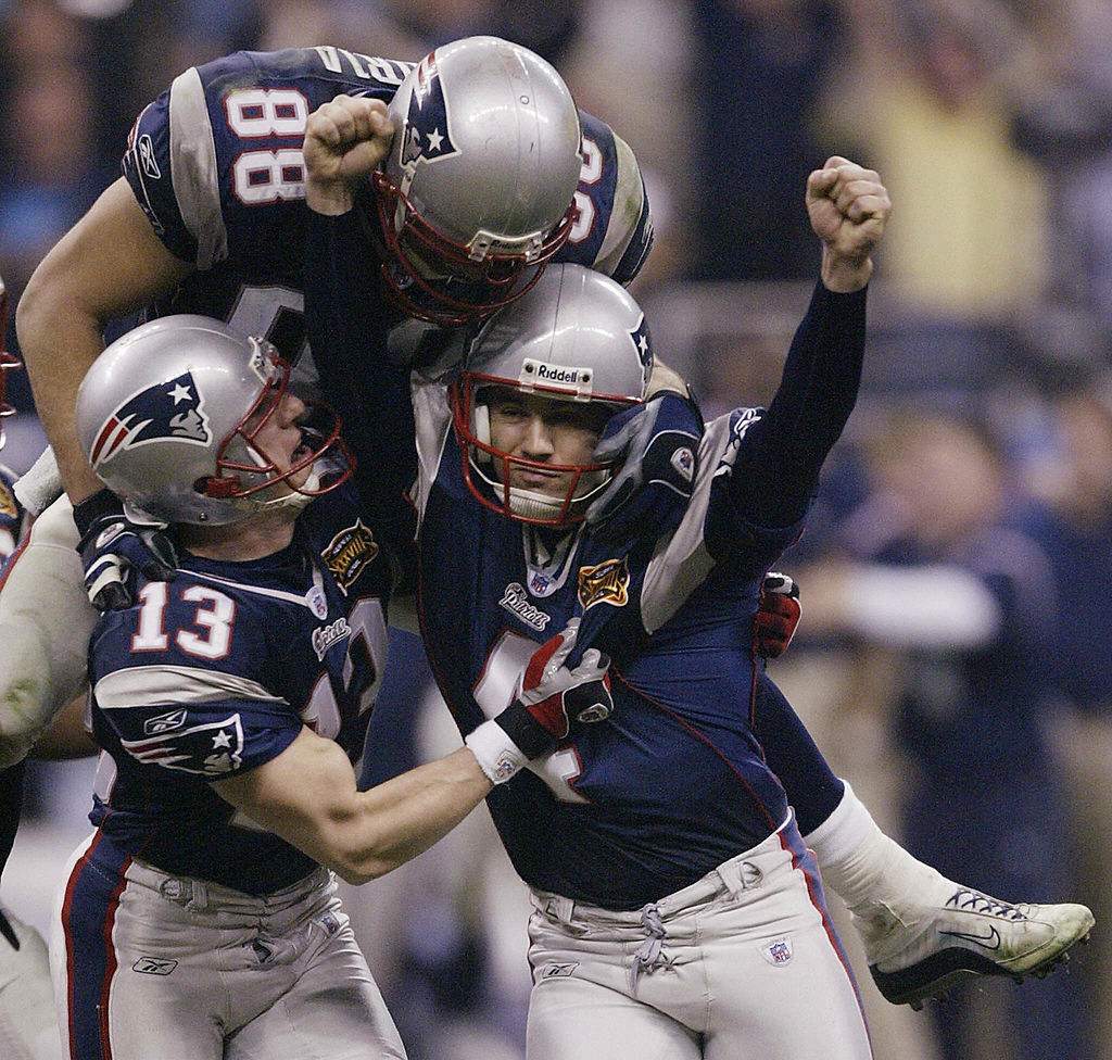 New England Patriots kicker Adam Vinatieri is congratulated after his game-winning, 41-yard field goal in the final seconds of Super Bowl XXXVIII against the Carolina Panthers.