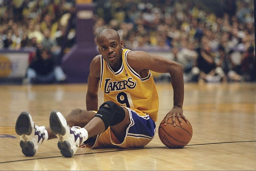 Nick Van Exel of the Los Angeles Lakers looks on during a game.