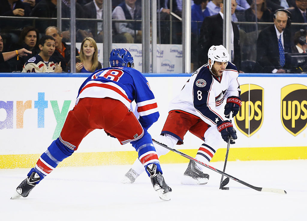 Nathan Horton of the Columbus Blue Jackets skates against Marc Staal of the New York Rangers.