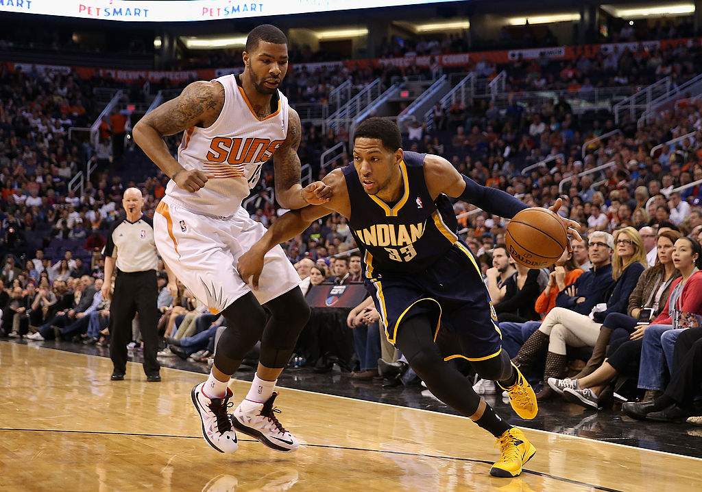 Danny Granger of the Indiana Pacers moves the ball past Marcus Morris of the Phoenix Suns.