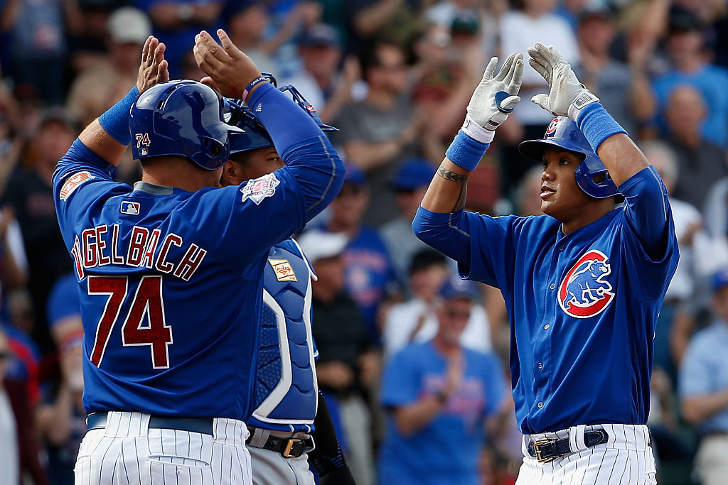 Dan Vogelbach of the Chicago Cubs high fives a teammate during the spring training game at Sloan Park.