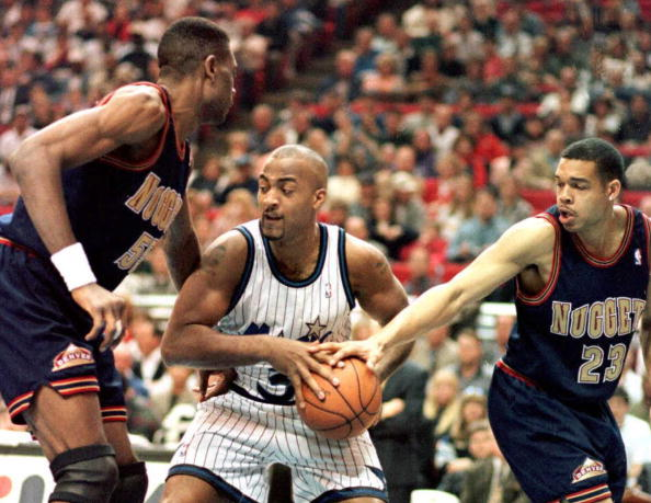 Orlando Magic forward Dennis Scott fights for control of the ball.