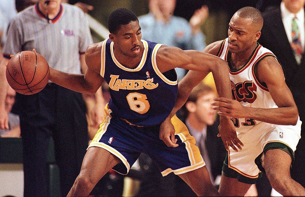 Los Angeles Lakers' Eddie Jones drives against Seattle SuperSonics' Hersey Hawkins.