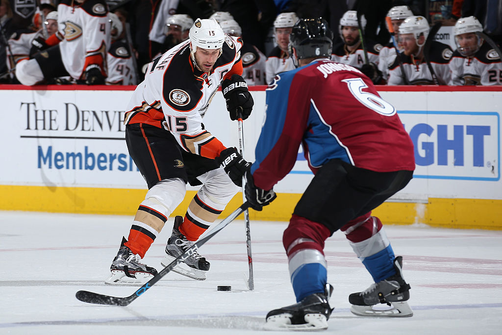 Erik Johnson goes for the puck.