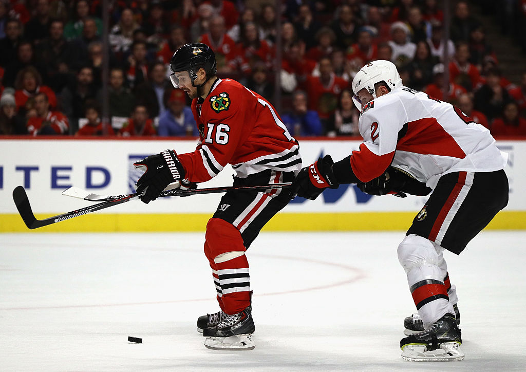 Dion Phaneuf goes for the puck against the Chicago Blackhawks.