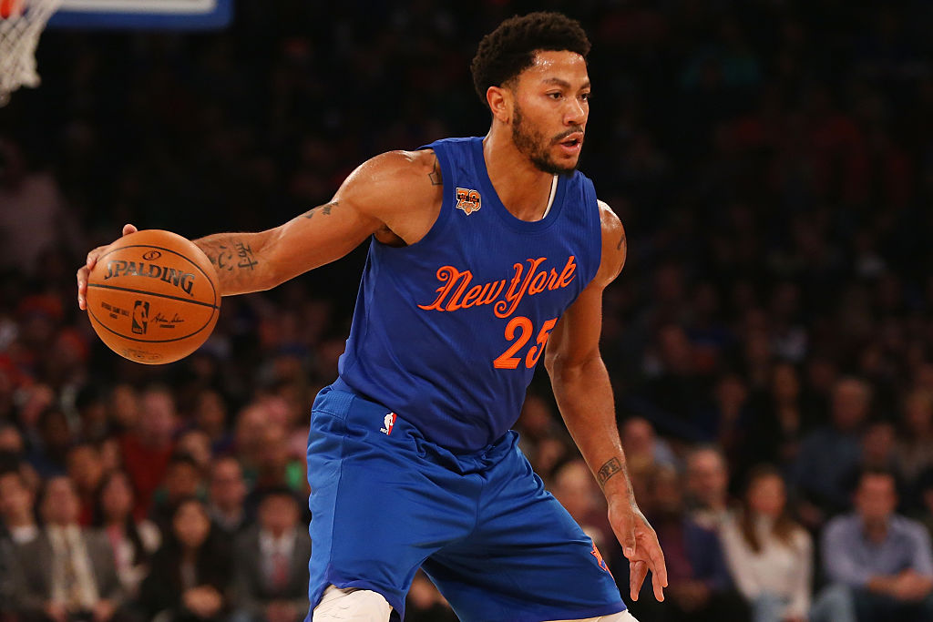 Derrick Rose of the New York Knicks dribbles the ball.