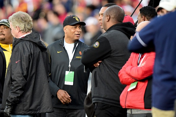 Ronnie Lott talks with Marcus Allen and Rodney Peete as the USC Trojans take on the Penn State Nittany Lions.