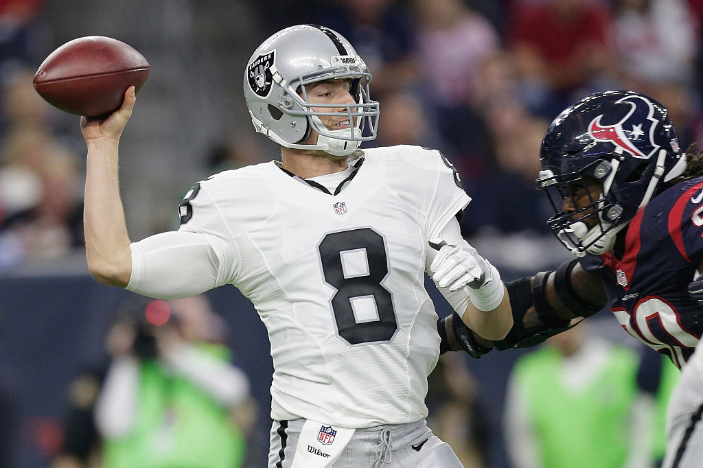 Connor Cook of the Oakland Raiders throws against the Houston Texans in the AFC Wild Card game
