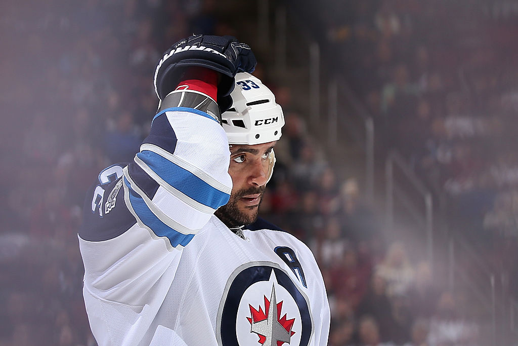 Dustin Byfuglien rests between plays.
