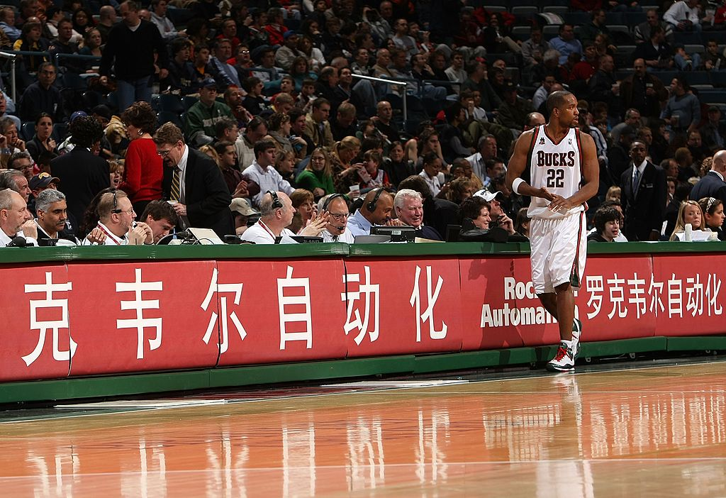 Michael Redd of the Milwaukee Bucks walks in front of the scorers' table.