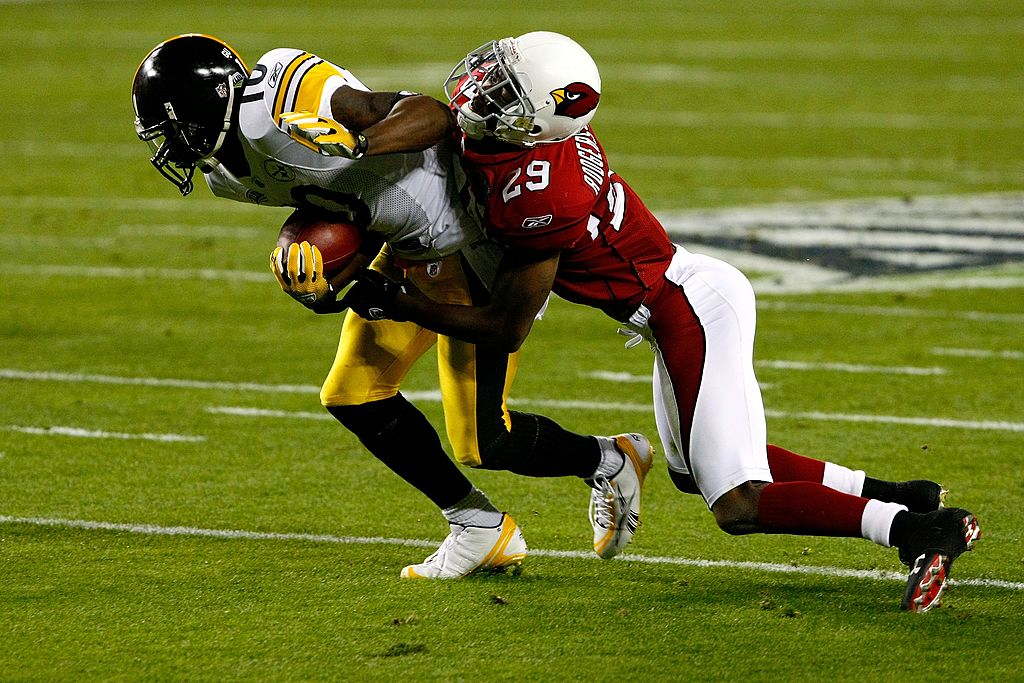 Santonio Holmes of the Pittsburgh Steelers runs for yards after the catch against Dominique Rodgers-Cromartie of the Arizona Cardinals.