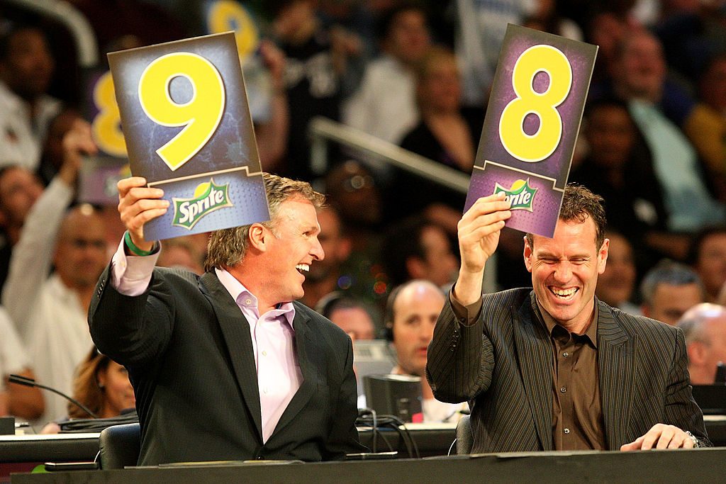 Tom Chambers and Dan Majerle hold up scores during the Sprite Slam Dunk Contest during the 2009 NBA All-Star Weekend.
