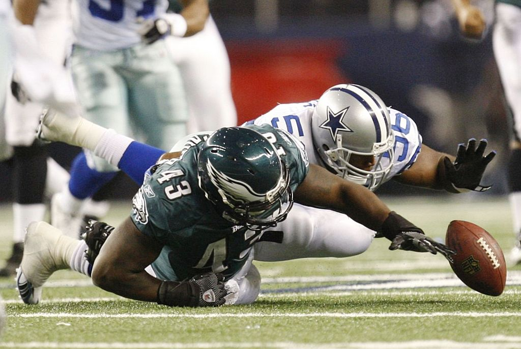 Fullback Leonard Weaver of the Philadelphia Eagles fumbles the ball which was recovered by the Dallas Cowboys.