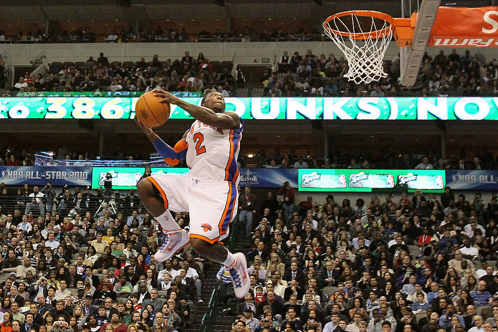 Nate Robinson of the New York Knicks attempts a dunk during the Sprite Slam Dunk Contest.