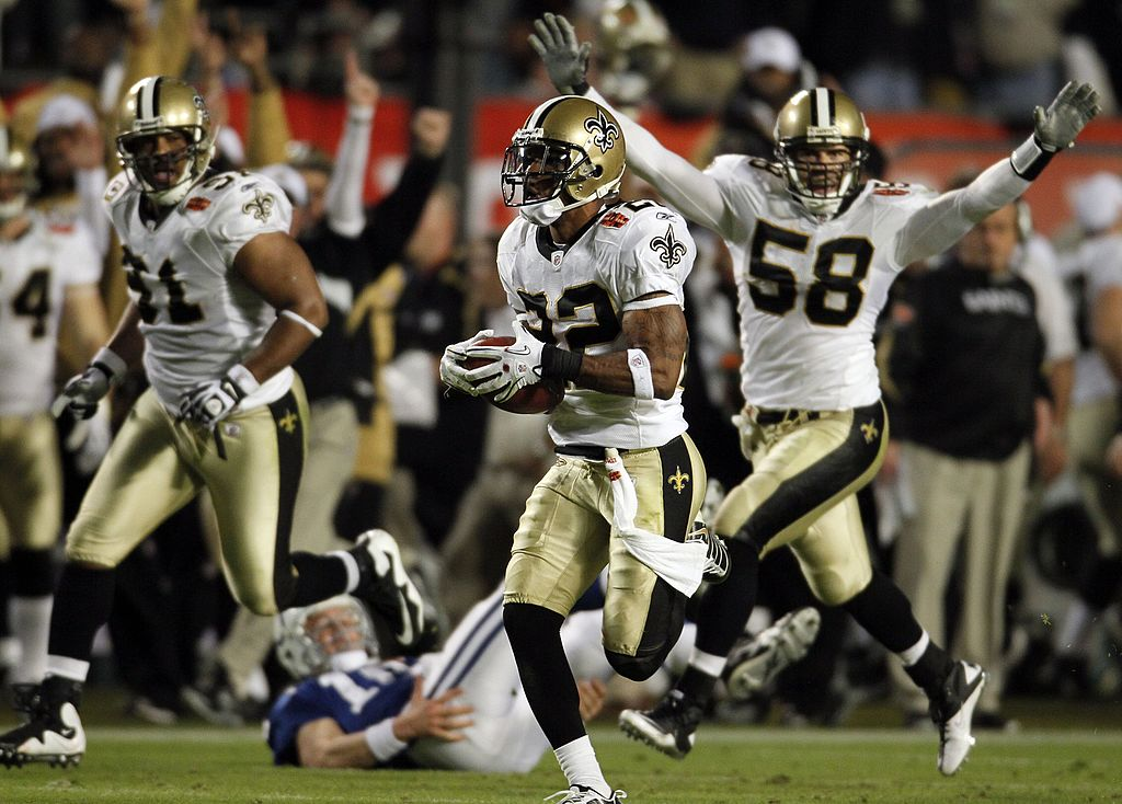 Tracy Porter of the New Orleans Saints intercepts a ball thrown by Peyton Manning and returns it for a touchdown.