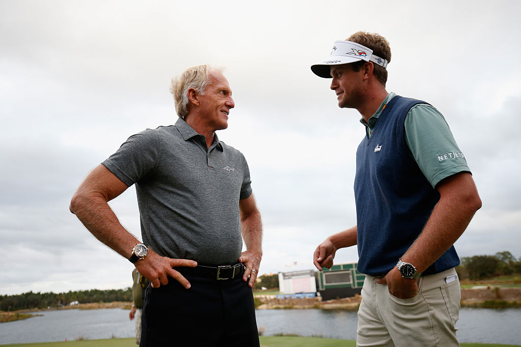 Greg Norman and Harris English chat on the 18th green following the final round of the Franklin Templeton Shootout at Tiburon Golf Club on December 10, 2016 in Naples, Florida. | Chris Trotman/Getty Images