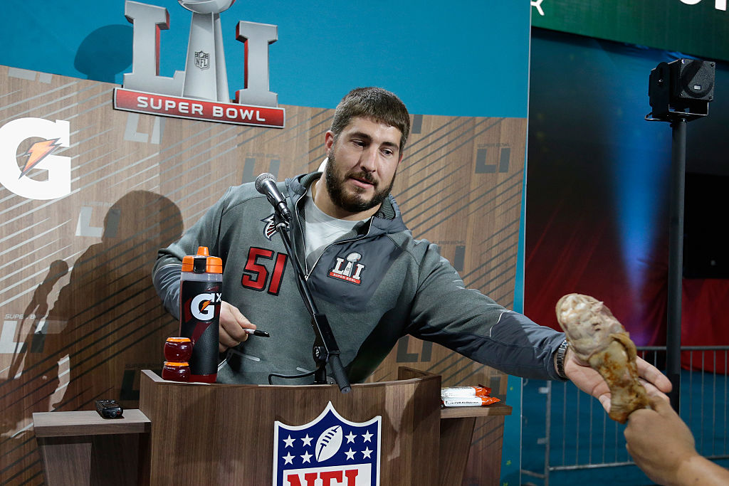 Alex Mack of the Atlanta Falcons reaches for a chicken wing during Jimmie Kimmel Live
