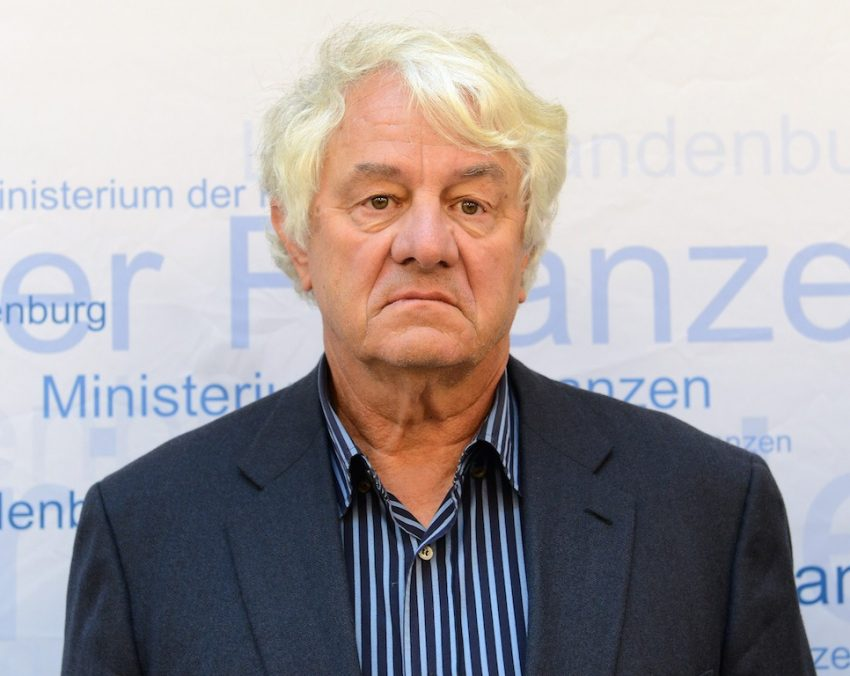Hasso Plattner stands at a media event.