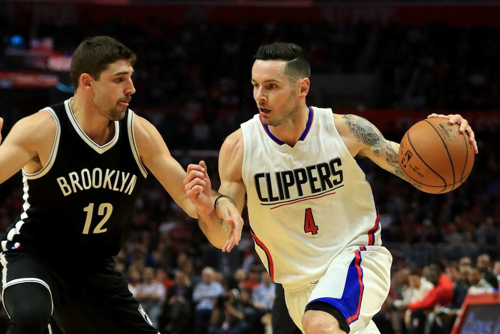 J.J. Redick dribbles past the Brooklyn Nets.