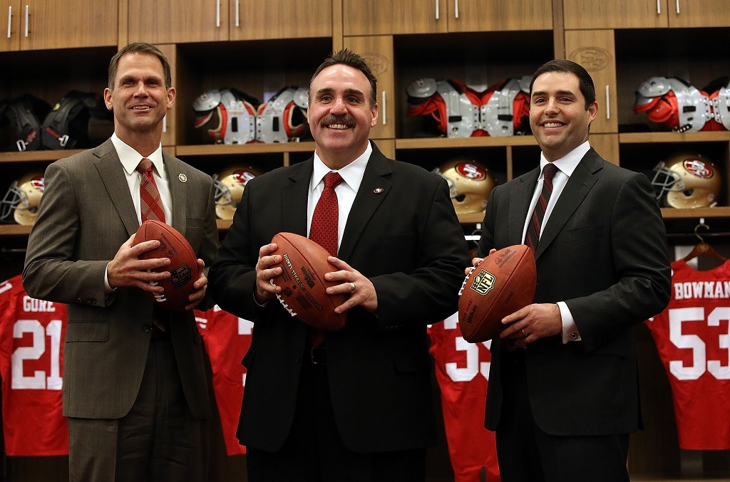 Jim Tomsula (C) stands with San Francisco 49ers CEO Jed York (R) and 49ers general manager Trent Baalke following a press conference