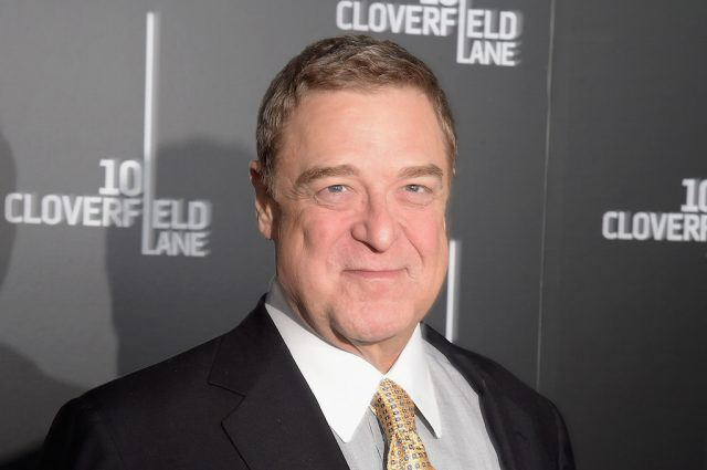 Actor John Goodman appears on the red carpet at a movie premiere.
