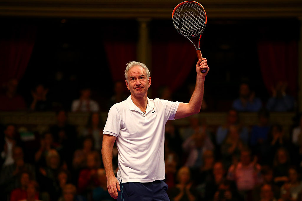 John McEnroe acknowledges the crowd at a match.