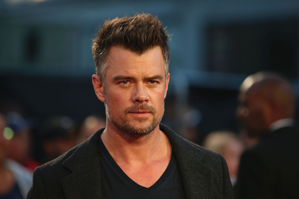 Actor Josh Duhamel stands on the red carpet at an event.
