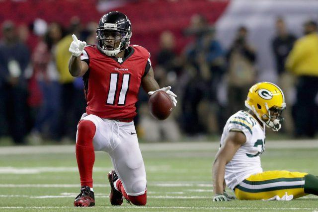 The Atlanta Falcons' Julio Jones points as his competition after a great play.