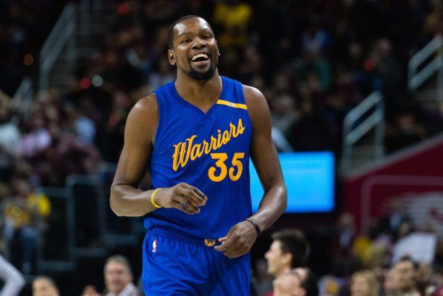 Kevin Durant laughs before a game.