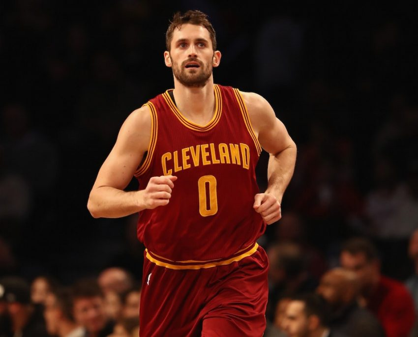 Kevin Love looks at the scoreboard and runs down the court.