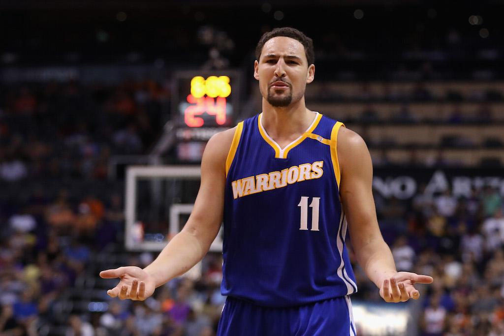 Klay Thompson argues a call with the referee.