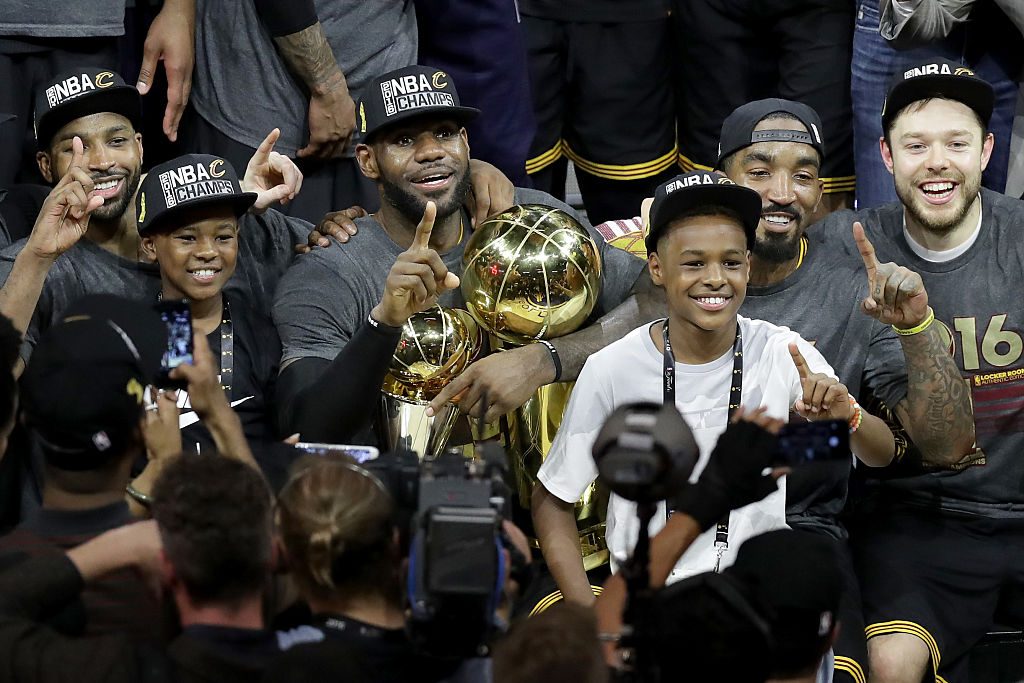 LeBron James of the Cleveland Cavaliers celebrates with his sons LeBron Jr. and Bryce after winning the 2016 NBA Finals | Ronald Martinez/Getty Images