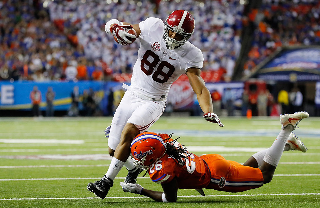 Marcell Harris #26 of the Florida Gators tackles O.J. Howard #88 of the Alabama Crimson Tide