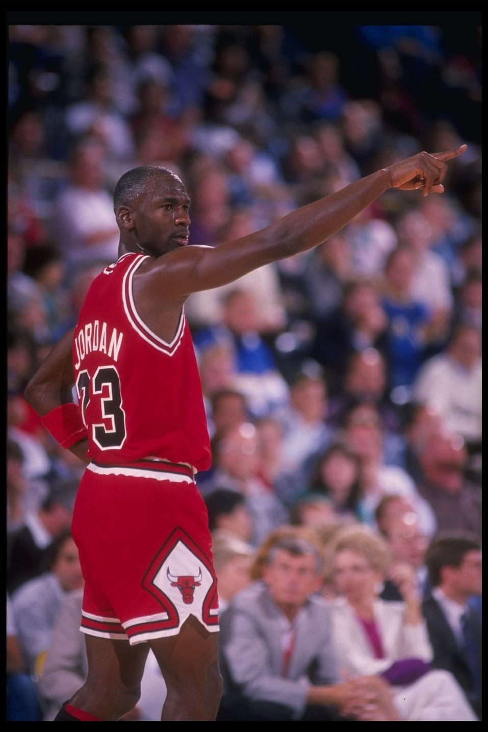 Michael Jordan points during a game.