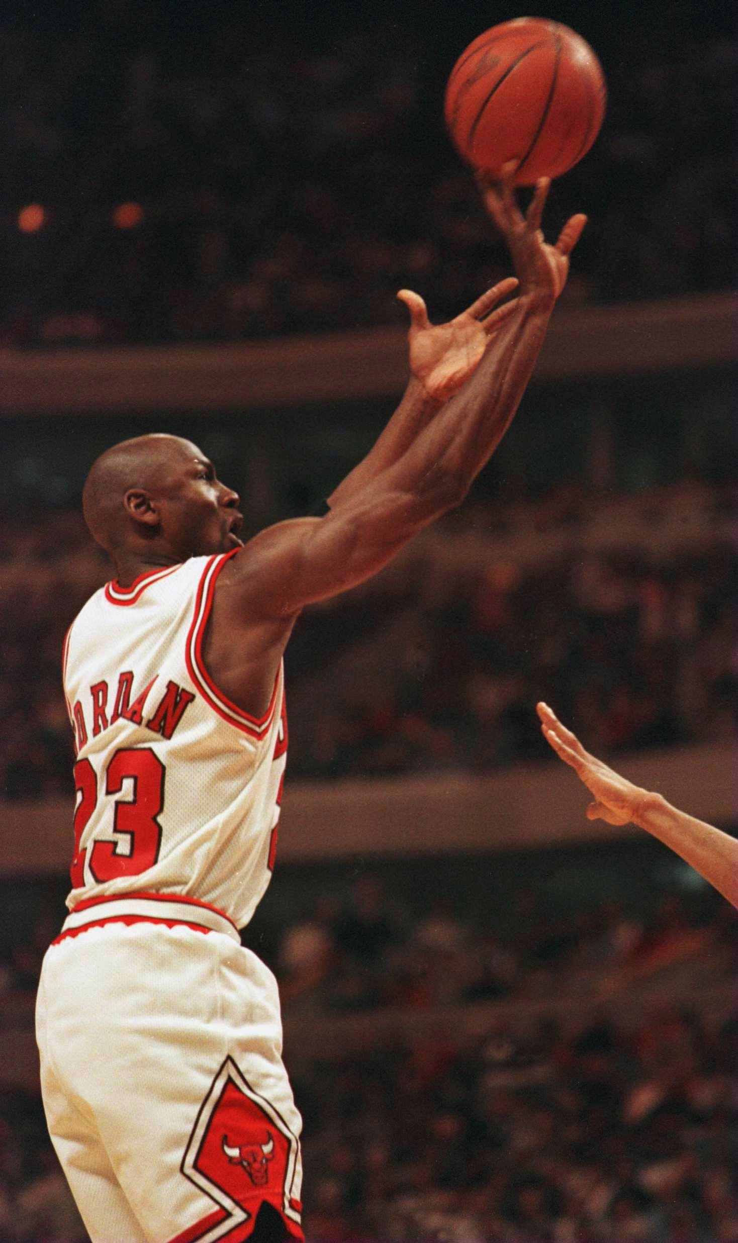 ce44c241723 Michael Jordan of the Chicago Bulls puts up a shot during the third quarter