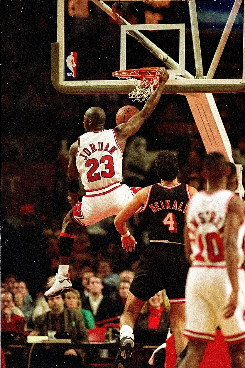 Michael Jordan of the Chicago Bulls dunks the ball.
