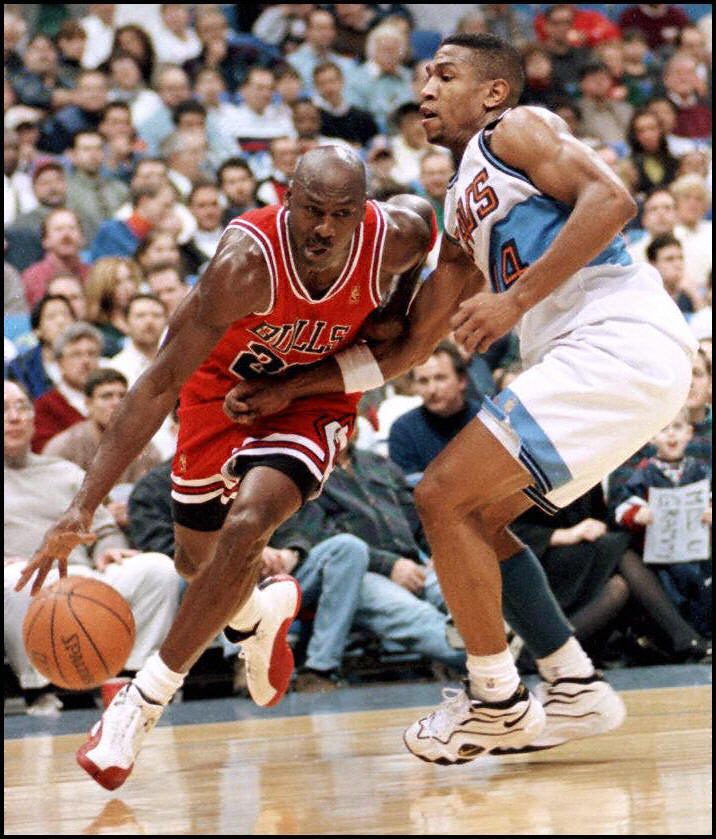 Chicago Bulls guard Michael Jordan drives from the basket against Bobby Phills of the Cleveland Cavaliers