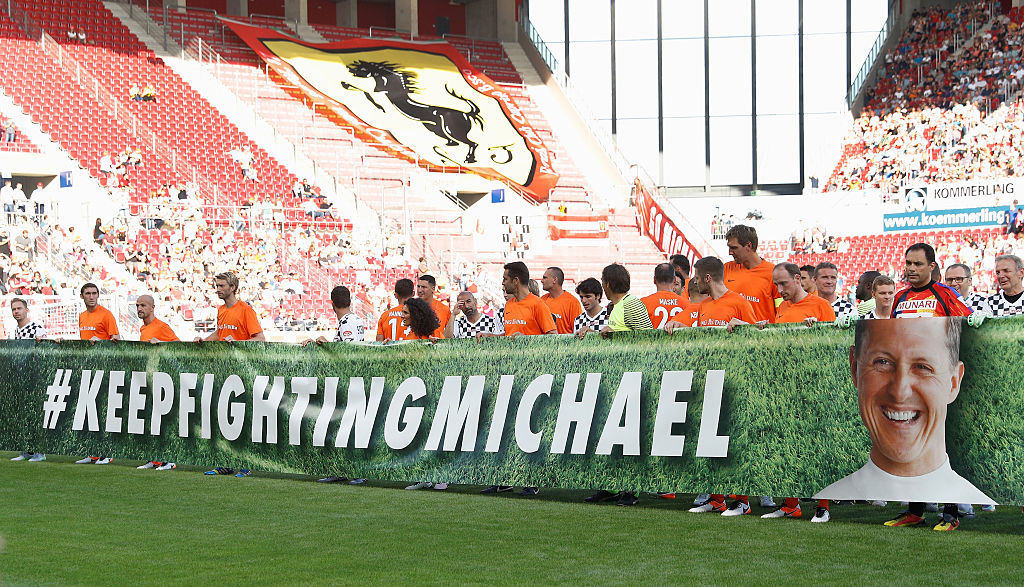 "Both teams hold up a banner that reads ""Keep fighting Michael"" prior to the Champions for Charity football match between Nowitzki All Stars and Nazionale Piloti in honor of Michael Schumacher."