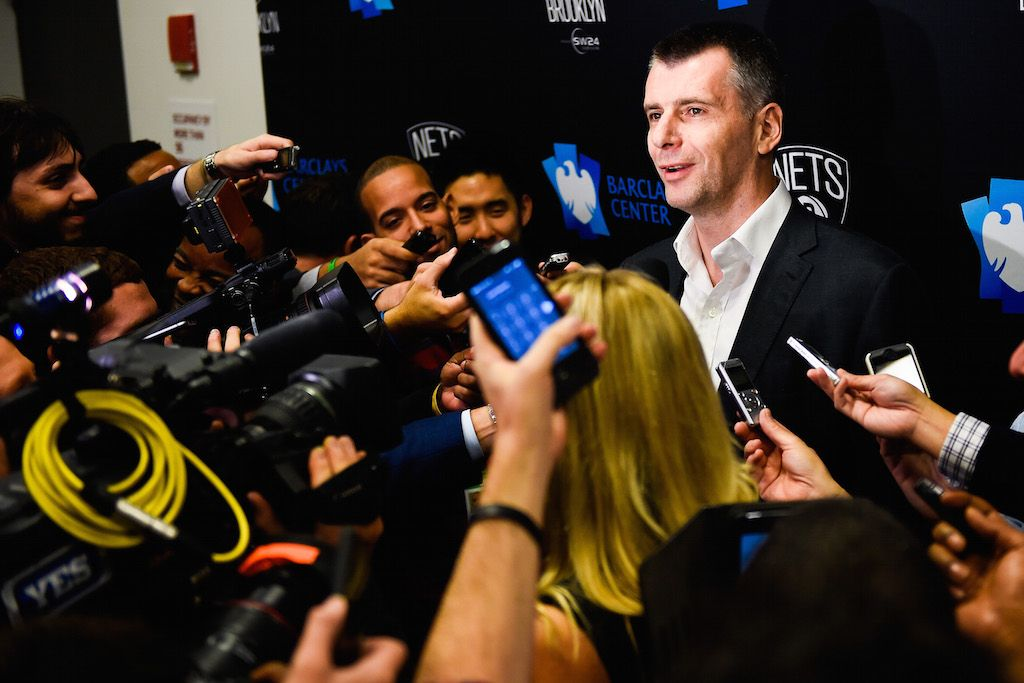 Mikhail Prokhorov speaks to the media after a game.