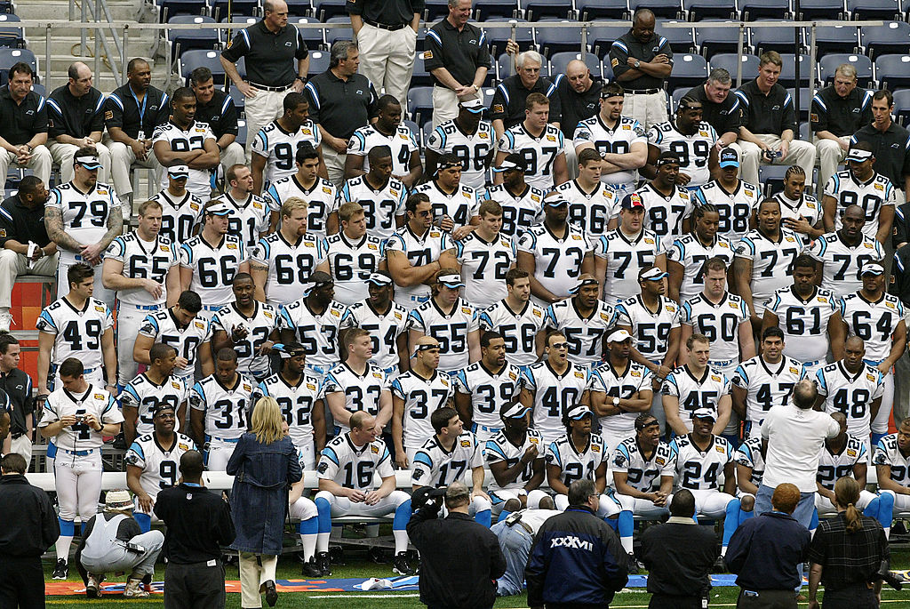 The Carolina Panthers prepare for a team photo on media day at Reliant Stadium