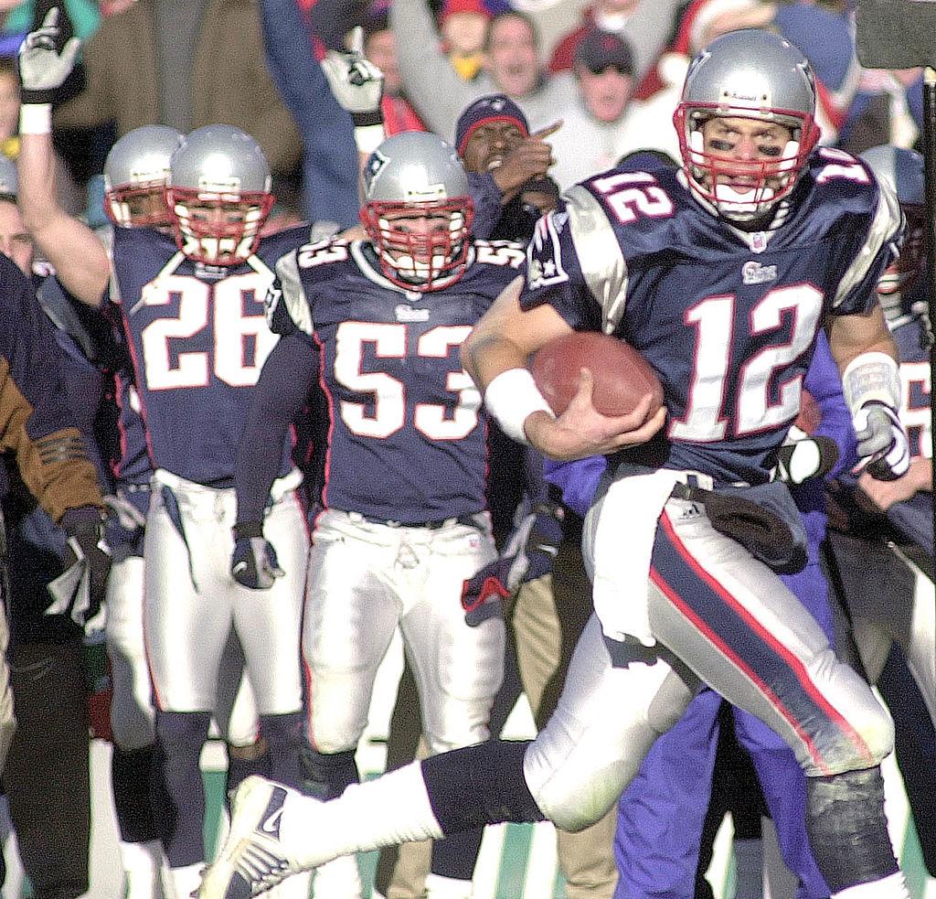 Quarterback Tom Brady of the New England Patriots runs the ball
