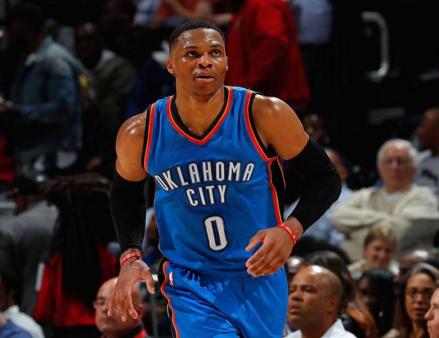Russell Westbrook looks at the scoreboard as he subs in.